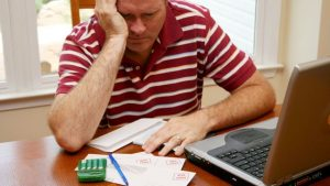 man-bills-struggling-upset-worried